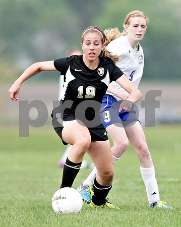 Monica Maschak - mmaschak@shawmedia.com<br /> Anna Haub leads with the ball in the Class 2A Sycamore Regional finals against Burlington on Friday, May 17, 2013. The Spartans won 1-0.