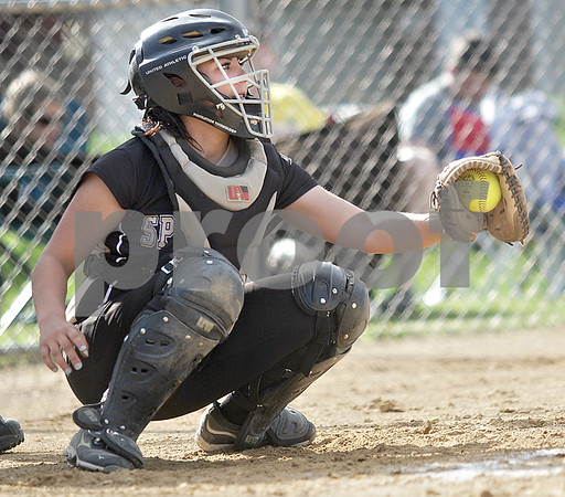 Monica Maschak - mmaschak@shawmedia.com<br /> Bobbie Gable catches an unhit ball behind home plate in the Class 3A Sycamore Regional semifinals against Burlington Central on Tuesday, May 21, 2013. The game was called after six innings when the Spartans were down 11-1.
