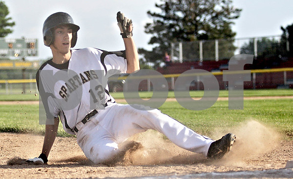 Monica Maschak - mmaschak@shawmedia.com<br /> Mark Skelley slides into third base in the fourth inning of the Class 3A Sycamore Sectional semifinals against Rockford East on Thursday, May 30, 2013. The Spartans shutout the E-Rabs 10-0 in six innings.