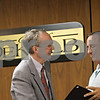 Rob Winner – rwinner@shawmedia.com<br /> <br /> Mayor Kris Povlsen (left) receives a resolution on Monday, April 22, 2013, commending and congratulating him for 16 years of service to the city as mayor and 2nd Ward alderman from 6th Ward Alderman David Baker during Monday night's DeKalb City Council meeting.<br /> <br /> DeKalb, Ill.