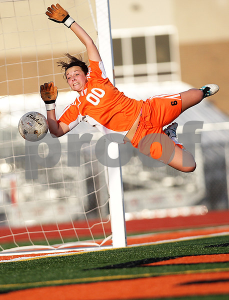 Monica Maschak - mmaschak@shawmedia.com<br /> <br /> DeKalb goalie Maddie Frye saves a ball from an attempted Sycamore free kick during the first half of a match on Tuesday, April 30, 2013. The Barbs beat the Spartans 1-0.