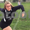 Monica Maschak - mmaschak@shawmedia.com<br /> Elle Tattoni, for Kaneland, rotates before releasing the discus at the Northern Illinois Big 12 Conference Girls Track and Field Championships at DeKalb High School on Friday, May 3, 2013.