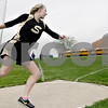 Monica Maschak - mmaschak@shawmedia.com<br /> Sycamore's Alyssa Fierbach spins in preparation to release her discus at a Class 2A Burlington Central Sectional track meet on Friday, May 10, 2013.