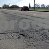 Rob Winner – rwinner@shawmedia.com<br /> <br /> Cracks on Twombly Road west of North Annie Glidden Road are seen in DeKalb, Ill., Friday, Nov. 8, 2013. DeKalb recently finished a road assessment that ranked which sections of local roads were the worst.