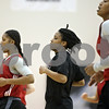 Rob Winner – rwinner@shawmedia.com<br /> <br /> Northern Illinois point guard Danny Pulliam (center) jogs with her teammates at the start of practice inside Victor E. Court at the Convocation Center in DeKalb on Wednesday, Nov. 6, 2013.
