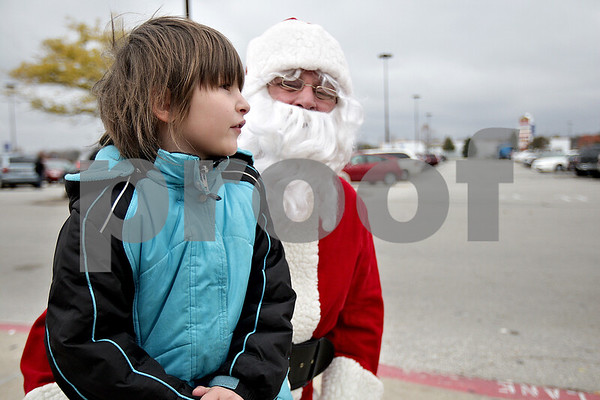 Monica Maschak - mmaschak@shawmedia.com<br /> Morgan Hadley, 8, tells Santa what she wants for Christmas during the Toys For Tots drive at the DeKalb Walmart on Saturday, November 2, 2013.
