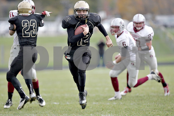 Monica Maschak - mmaschak@shawmedia.com<br /> Quarterback Nick Feuerback cuts up the middle in the second quarter against Antioch in the first round of the IHSA Class 5A playoffs on Saturday, November 2, 2013. Sycamore won 48-24, moving them to the second round in the playoffs.