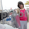 Monica Maschak - mmaschak@shawmedia.com<br /> Rene Polz donates a toy to the Toys For Tots drive at the DeKalb Walmart on Saturday, November 2, 2013.