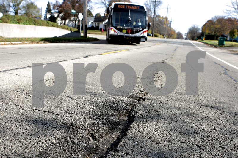 Rob Winner – rwinner@shawmedia.com<br /> <br /> A bus turns right on to West Taylor Street traveling westbound in DeKalb, Ill., Friday, Nov. 8, 2013. DeKalb recently finished a road assessment that ranked which sections of local roads were the worst.