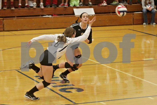 Rob Winner – rwinner@shawmedia.com<br /> <br /> Sycamore's Christina Dailey (8) and Mallory Wolf are unable to get to a ball that falls for a LaSalle-Peru point in the second game during the Class 3A Princeton Sectional final on Thursday, November 7, 2014. LaSalle-Peru  defeated Sycamore, 25-18, 25-20.