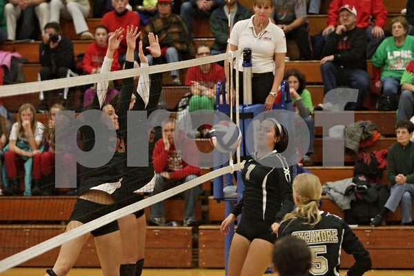 Rob Winner – rwinner@shawmedia.com<br /> <br /> Sycamore's Gabrielle Wenger (7) has her spike blocked in the second game during the Class 3A Princeton Sectional final on Thursday, November 7, 2014. LaSalle-Peru  defeated Sycamore, 25-18, 25-20.