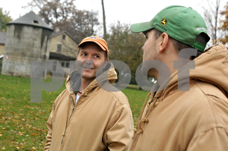 Rob Winner – rwinner@shawmedia.com<br /> <br /> Owner Daren Friesen (left) and manager Jacob Mueller discuss work that needs to be completed at Stonehouse Farm in Earlville, Ill., Tuesday, Nov. 5, 2013. Friesen purchased the property earlier this year and is working to get the buildings up to code.