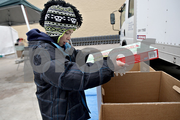 Monica Maschak - mmaschak@shawmedia.com<br /> Volunteer Garrison Eckhardt, 10, with Cub Scout Pack 104, sorts donated toys by age and gender during the Toys For Tots drive at the DeKalb Walmart on Saturday, November 2, 2013.