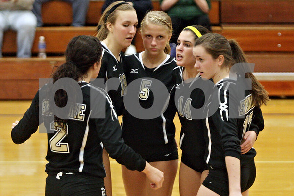 Rob Winner – rwinner@shawmedia.com<br /> <br /> Sycamore's Emily Young (from left to right), Shaeley McCoy, Kendra Larson, Jenee Carlson, and Shannon Maher gather after a LaSalle-Peru point late in the second game during the Class 3A Princeton Sectional final on Thursday, November 7, 2014. LaSalle-Peru  defeated Sycamore, 25-18, 25-20.