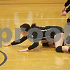 Rob Winner – rwinner@shawmedia.com<br /> <br /> Sycamore's Emily Young is unable to save a ball in the second game during the Class 3A Princeton Sectional final on Thursday, November 7, 2014. LaSalle-Peru  defeated Sycamore, 25-18, 25-20.