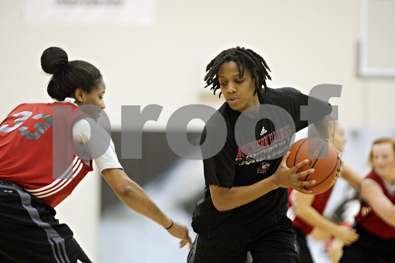 Rob Winner – rwinner@shawmedia.com<br /> <br /> Northern Illinois point guard Danny Pulliam (right) practices with teammate Jazmine Harris (33) inside Victor E. Court at the Convocation Center in DeKalb on Wednesday, Nov. 6, 2013.