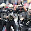 Monica Maschak - mmaschak@shawmedia.com<br /> Defensive tackle Derek Stenberg raises the ball after recovering a fumble from Antioch in the first quarter during the first round of the IHSA Class 5A playoffs on Saturday, November 2, 2013. Sycamore won 48-24, moving them to the second round in the playoffs.