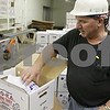 Rob Winner – rwinner@shawmedia.com<br /> <br /> Robert Kaufmann of Ho-Ka Turkey Farm in Waterman shows a packaged turkey on Tuesday, Nov. 5, 2013.