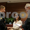 Rob Winner – rwinner@shawmedia.com<br /> <br /> Steven Estes of DeKalb and Annie Baccetti of Sandwich share a laugh with Judge Thomas L. Doherty during their wedding ceremony at the DeKalb County Courthouse in Sycamore, Ill., on Friday, Nov. 15, 2013. Estes is an Army Fire Support Specialist and will be deployed to Afghanistan in December.