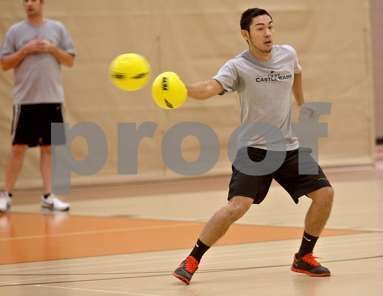 Monica Maschak - mmaschak@shawmedia.com<br /> Matthias Mehrpuyan, with team Castle Bank, redirects an oncoming ball during a dodgeball tournament at DeKalb High School on Saturday, November 9, 2013. The Ben Gordon Center held the 8th annual tournament to raise money for veterans services.