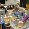 Rob Winner – rwinner@shawmedia.com<br /> <br /> Isabelle Sester, 8, of Genoa adds vegetables to a bag of food during the Feed My Starving Children mobile pack event at Cornerstone Christian Academy in Sycamore, Ill., Thursday, Nov. 14, 2013. The meals packed by the volunteers during this four-day event will be shipped across the world to fulfill the nutritional needs of starving children.
