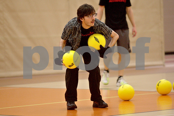 Monica Maschak - mmaschak@shawmedia.com<br /> Michael Fish, with team Sas Attacks, loads up on dodgeballs during a dodgeball tournament at DeKalb High School on Saturday, November 9, 2013. The Ben Gordon Center held the 8th annual tournament to raise money for veterans services.