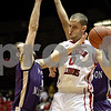 Monica Maschak - mmaschak@shawmedia.com<br /> Center Pete Rakocevic keeps the ball out of reach in the first quarter against James Madison on Friday, November 15, 2013.
