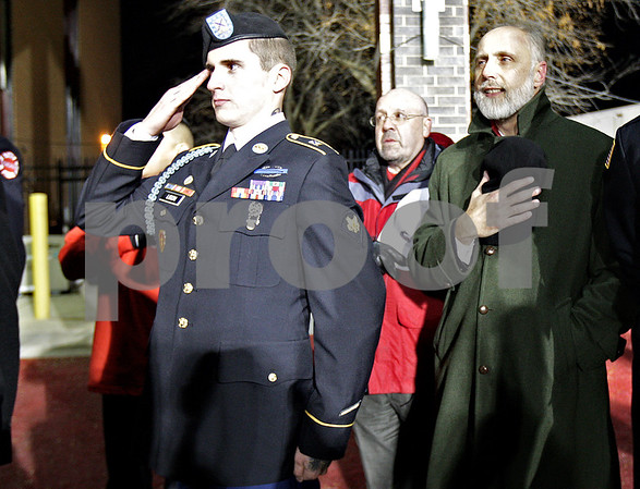 Monica Maschak - mmaschak@shawmedia.com<br /> U.S. Army Specialist Charles Ligon salutes during the National Anthem prior to the Northern Illinois football game at Huskie Stadium on Wednesday, November 13, 2013. Specialist Ligon was awarded with a 2013 Chevy Silverado crew cab pickup from the Associated Fire Fighters of Illinois Warrior Program.