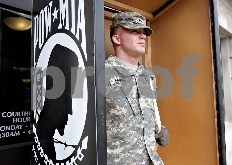 Monica Maschak - mmaschak@shawmedia.com<br /> Sgt. Sean Griffin stands in a wooden box to protect him from the wind during his five-hour shift in front of the DeKalb County Court House on Saturday, November 9, 2013. Veterans took turns keeping vigil from 6 p.m. Friday to 6 p.m. Saturday.