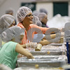 Rob Winner – rwinner@shawmedia.com<br /> <br /> Cori Felts of Oregon Isabelle Sester, 8, of Genoa adds soy and rice to a bag of food during the Feed My Starving Children mobile pack event at Cornerstone Christian Academy in Sycamore, Ill., Thursday, Nov. 14, 2013. The meals packed by the volunteers during this four-day event will be shipped across the world to fulfill the nutritional needs of starving children.