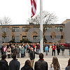 Rob Winner – rwinner@shawmedia.com<br /> <br /> Michael John Poorten finishes lowering the flag to half-staff during the observance of Veterans Day at Sycamore High School on Monday, Nov. 11, 2013.