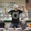 Rob Winner – rwinner@shawmedia.com<br /> <br /> Ryan Hudson, 14, of DeKalb dances to music while sorting bags of food during the Feed My Starving Children mobile pack event at Cornerstone Christian Academy in Sycamore, Ill., Thursday, Nov. 14, 2013. The meals packed by the volunteers during this four-day event will be shipped across the world to fulfill the nutritional needs of starving children.