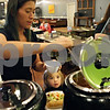 Rob Winner – rwinner@shawmedia.com<br /> <br /> Gina Abitua of Kingston chooses a soup for her daughter Toni Abitua, 4, while getting food at the all-you-can-eat lunch bar at Feed'em Soup in DeKalb on Wednesday, Nov. 13, 2013.