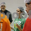 Rob Winner – rwinner@shawmedia.com<br /> <br /> Feed My Starving Children mobile pack team leader Molly Potter instructs a group a volunteers before they begin working at Cornerstone Christian Academy in Sycamore, Ill., Thursday, Nov. 14, 2013. The meals packed by the volunteers during this four-day event will be shipped across the world to fulfill the nutritional needs of starving children.