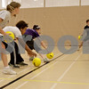 Monica Maschak - mmaschak@shawmedia.com<br /> Team Alpha Omega Epsilon (left) and team Skulls race for the dodgeballs in the middle of the court during a dodgeball tournament at DeKalb High School on Saturday, November 9, 2013. The Ben Gordon Center held the 8th annual tournament to raise money for veterans services.