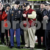 Monica Maschak - mmaschak@shawmedia.com<br /> U.S. Army Specialist Charles Ligon receives keys to his new car from the honorary captain of the Northern Illinois football team Albert Riipi during the game at Huskie Stadium on Wednesday, November 13, 2013. Specialist Ligon was awarded with a 2013 Chevy Silverado crew cab pickup from the Associated Fire Fighters of Illinois Warrior Program.