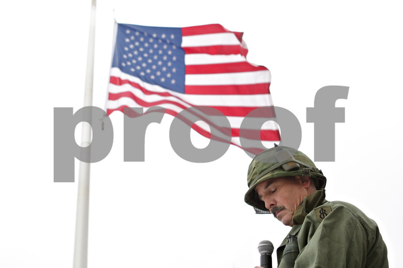 Rob Winner – rwinner@shawmedia.com<br /> <br /> Sycamore resident and veteran Steven Munz pauses while giving a speech outside of Sycamore High School during an observance of Veterans Day on Monday morning. Munz served in the Army from 1972 until 1992.