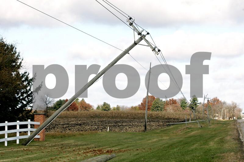 Rob Winner – rwinner@shawmedia.com<br /> <br /> Damaged utility poles are seen along Route 23 south of Gurler Road on Monday, Nov. 18, 2013.