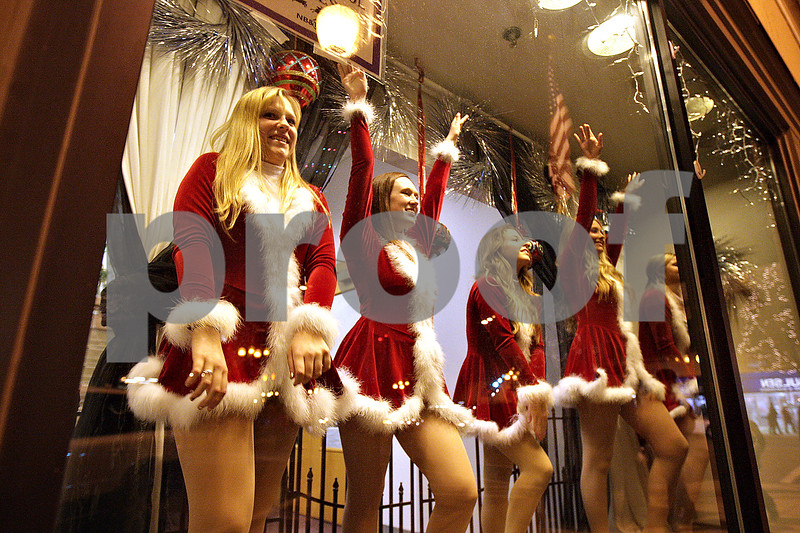 Monica Maschak - mmaschak@shawmedia.com<br /> The Sycamore High School Orchesis dances in a window of the city building during Moonlight Madness in downtown Sycamore on Friday, November 22, 2013. Storefronts were filled with holiday scenes.