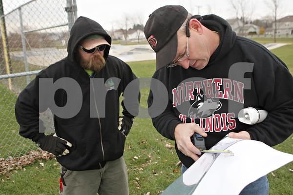 Rob Winner – rwinner@shawmedia.com<br /> <br /> Josh Clark (left) and Todd Bex look over plans for a temporary dog park located at Katz Park in DeKalb, Ill., Wednesday, Nov. 20, 2013.
