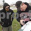 Rob Winner – rwinner@shawmedia.com<br /> <br /> Josh Clark (left) and Todd Bex look over plans for a temporary dog park located at Katz Park in DeKalb, Ill., Wednesday, Nov. 20, 2013.