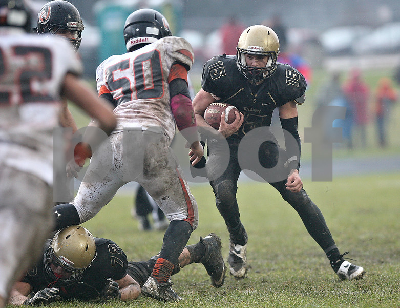 Monica Maschak - mmaschak@shawmedia.com<br /> Quarterback Devin Mottet carries the ball in the second quarter of a Class 5A Quarterfinal game against Lincoln-Way West on Saturday, November 16, 2013. The Spartans beat the Warriors 21-14 and will move on to play Montini next week.
