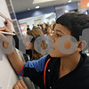 "Rob Winner – rwinner@shawmedia.com<br /> <br /> Eighth grader Jayson Lisk, 14, signs a wall at Genoa-Kingston Middle School to show his commitment to stopping and reporting bullying on Friday, Nov. 22, 2013. The ""I want you Say it if you See it!"" wall is part of a monthlong event to encourage students to stop being bystanders when they see bullying."