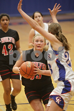 Rob Winner – rwinner@shawmedia.com<br /> <br /> Indian Creek's Olivia Harvell (33) drives to the basket as Genoa-Kingston's Andrea Strohmaier defends during the second quarter in Genoa, Ill., Monday, Nov. 18, 2013.