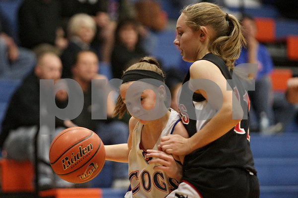Rob Winner – rwinner@shawmedia.com<br /> <br /> Genoa-Kingston's Julie Galauner (left) is pressured by Indian Creek's Madison Russell during the first quarter in Genoa, Ill., Monday, Nov. 18, 2013.