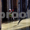 Rob Winner – rwinner@shawmedia.com<br /> <br /> A construction worker is seen standing in the Kishwaukee River in Kingston, Ill., helping guide a crane operator as construction for the Five Points Road bridge continues in Kingston, Ill., Friday, Nov. 15, 2013.