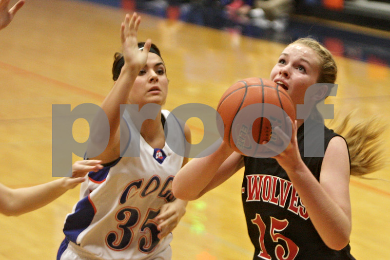 Rob Winner – rwinner@shawmedia.com<br /> <br /> Indian Creek's Emma Goodrich (15) puts up a shot good for two points and draws a foul during the second quarter in Genoa, Ill., Monday, Nov. 18, 2013.