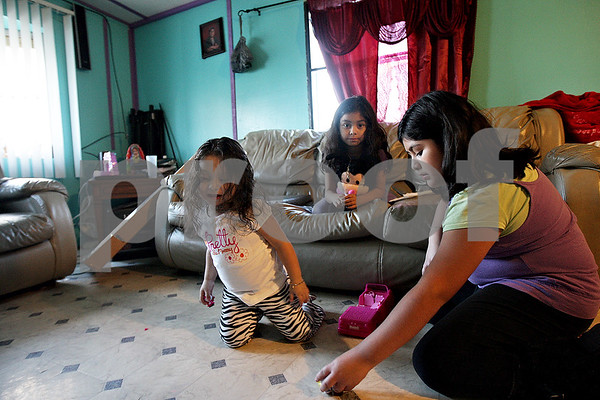 Monica Maschak - mmaschak@shawmedia.com<br /> The Hernandez sisters (from left), Gloria, a toddler, Beatriz, 7, and Carla, 10, play together in their family's home located in Evergreen Village in Sycamore. The residents of the trailer community will be forced to relocate in the coming year and some families, like the Hernandez's, are hoping to keep their children in their current schools. Both Carla, a fifth grader, and Beatriz, a second grader, attend North Grove Elementary School in Sycamore. Gloria is too young to attend school. The sisters also have two brothers attending Sycamore High School.