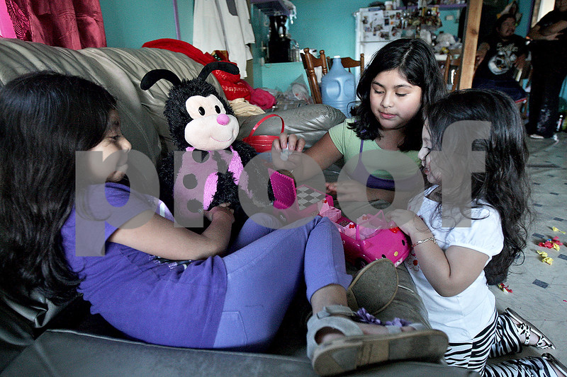 Monica Maschak - mmaschak@shawmedia.com<br /> The Hernandez sisters (from left), Beatriz, 7, Carla, 10, and the youngest Gloria, play together in their family's home located in Evergreen Village in Sycamore. The residents of the trailer community will be forced to relocate in the coming year and some families, like the Hernandez's, are hoping to keep their children in their current schools. Both Carla, a fifth grader, and Beatriz, a second grader, attend North Grove Elementary School in Sycamore. Gloria is too young to attend school. The sisters also have two brothers attending Sycamore High School.