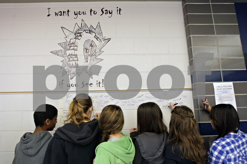 "Rob Winner – rwinner@shawmedia.com<br /> <br /> Students at Genoa-Kingston Middle School sign the ""I want you Say it if you See it!"" wall on Friday afternoon as part of a monthlong event to encourage students to stop being bystanders when they see bullying."